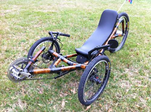 a recumbent trike made from bamboo poles